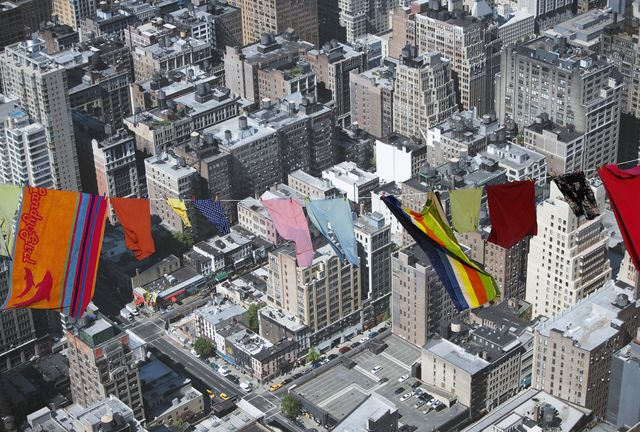 Washing line hung over cityscape (Digital Composite)