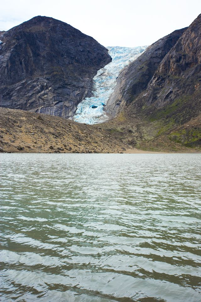 Glacier with river of meltwater in the Arctic